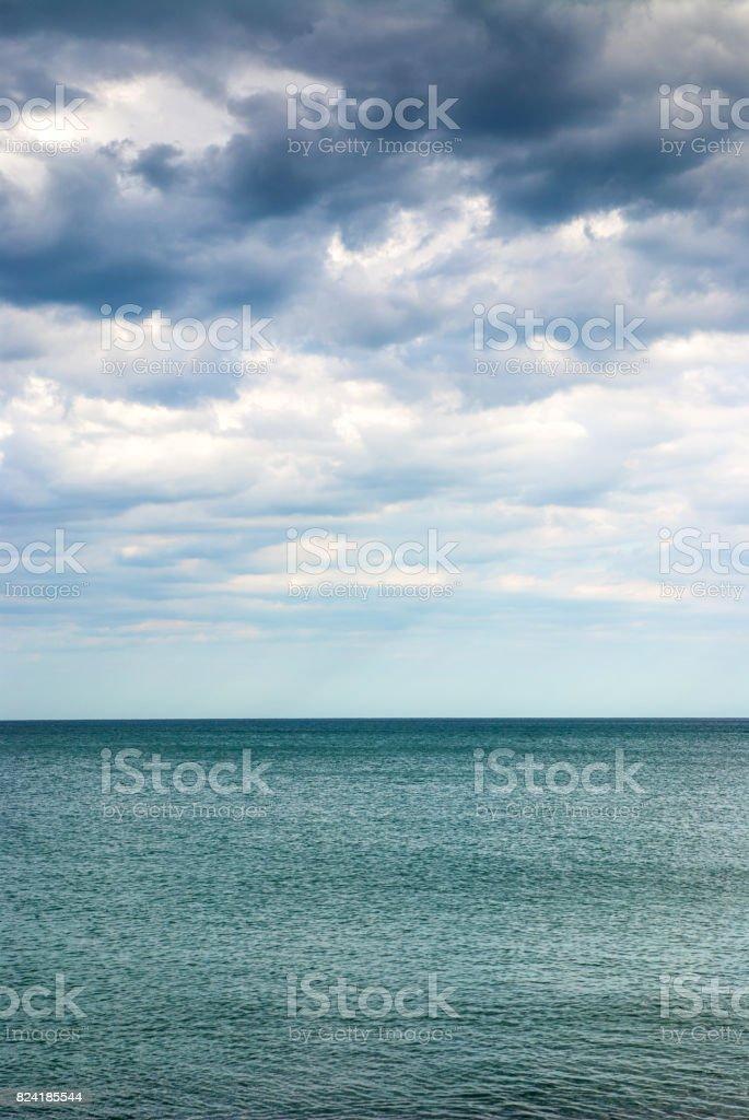 Stormy Weather - Sea Under Dark Blue Clouds stock photo