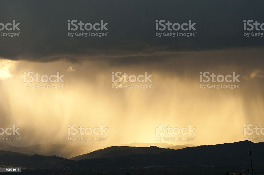 Stormy Weather with Clouds in Sky over Hills stock photo