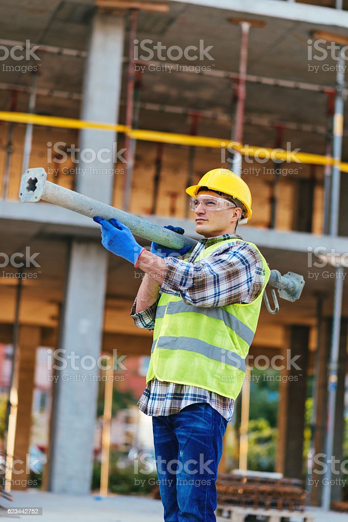 Storng construction worker on construction platform stock photo