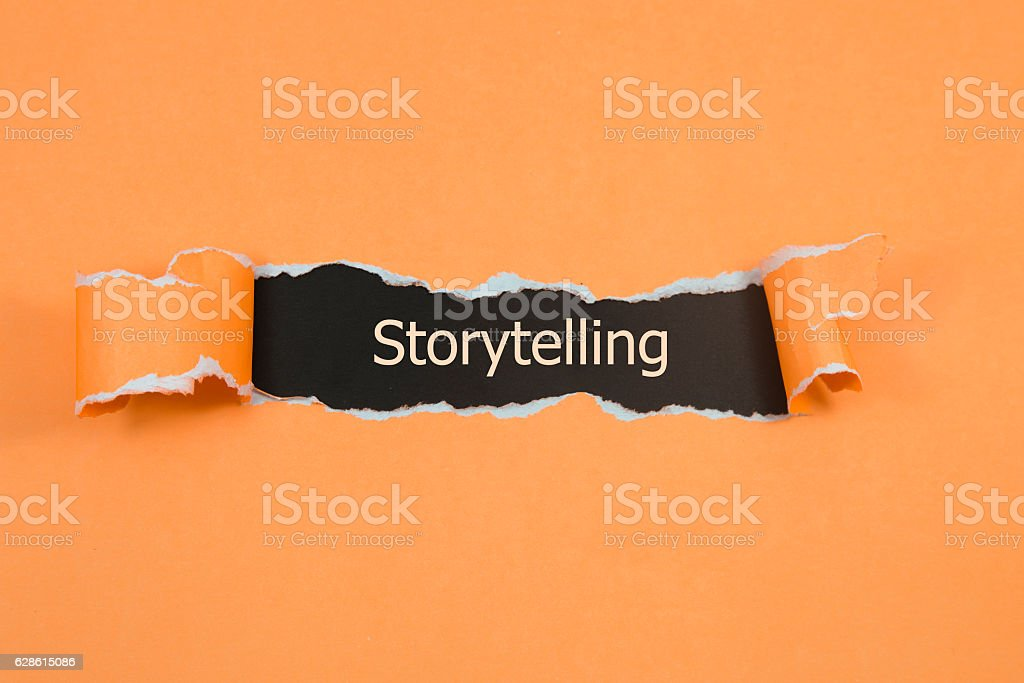 Storytelling written under torn paper stock photo