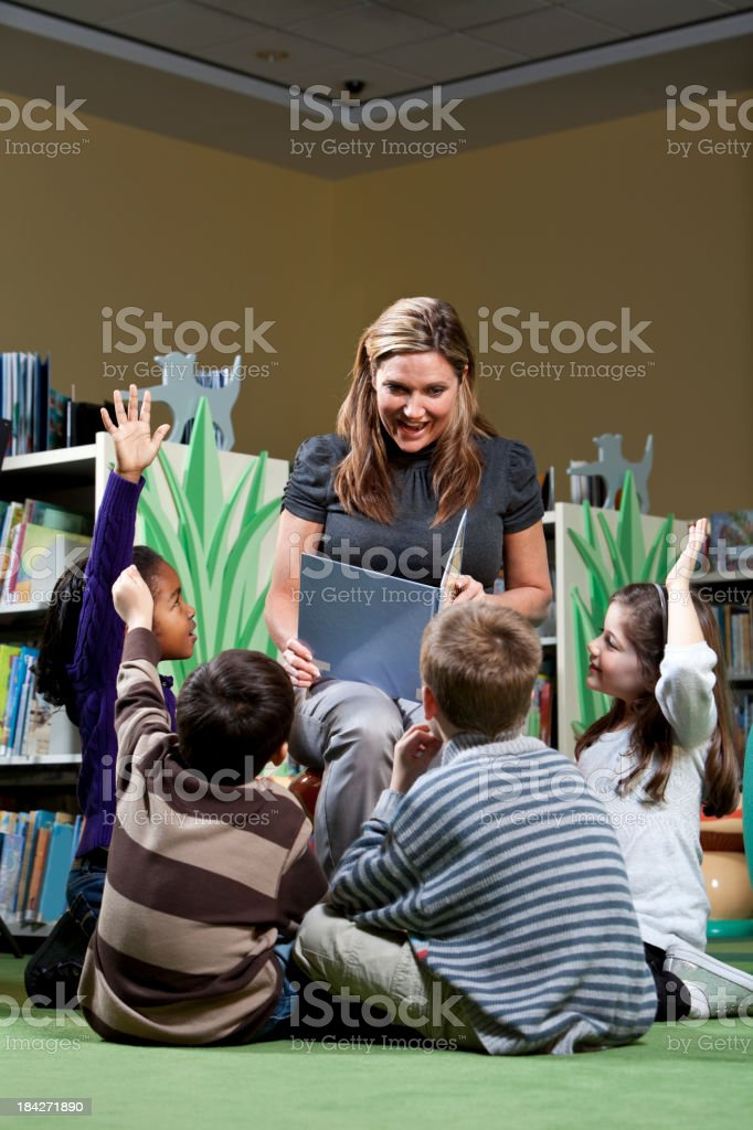 Storytime in the library stock photo