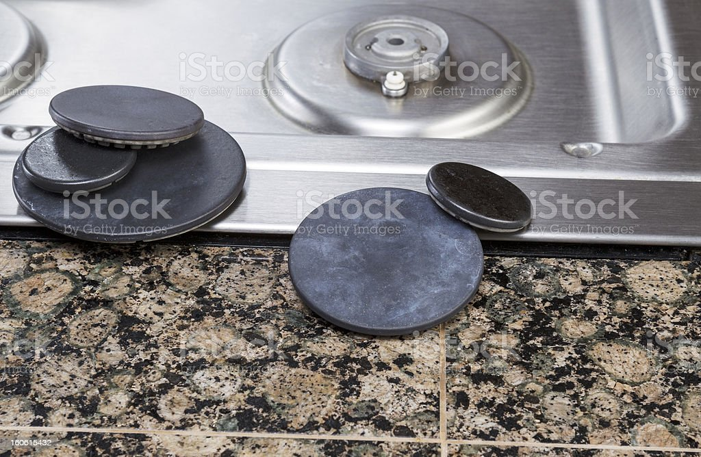 Stove Burner Covers Maintenance royalty-free stock photo