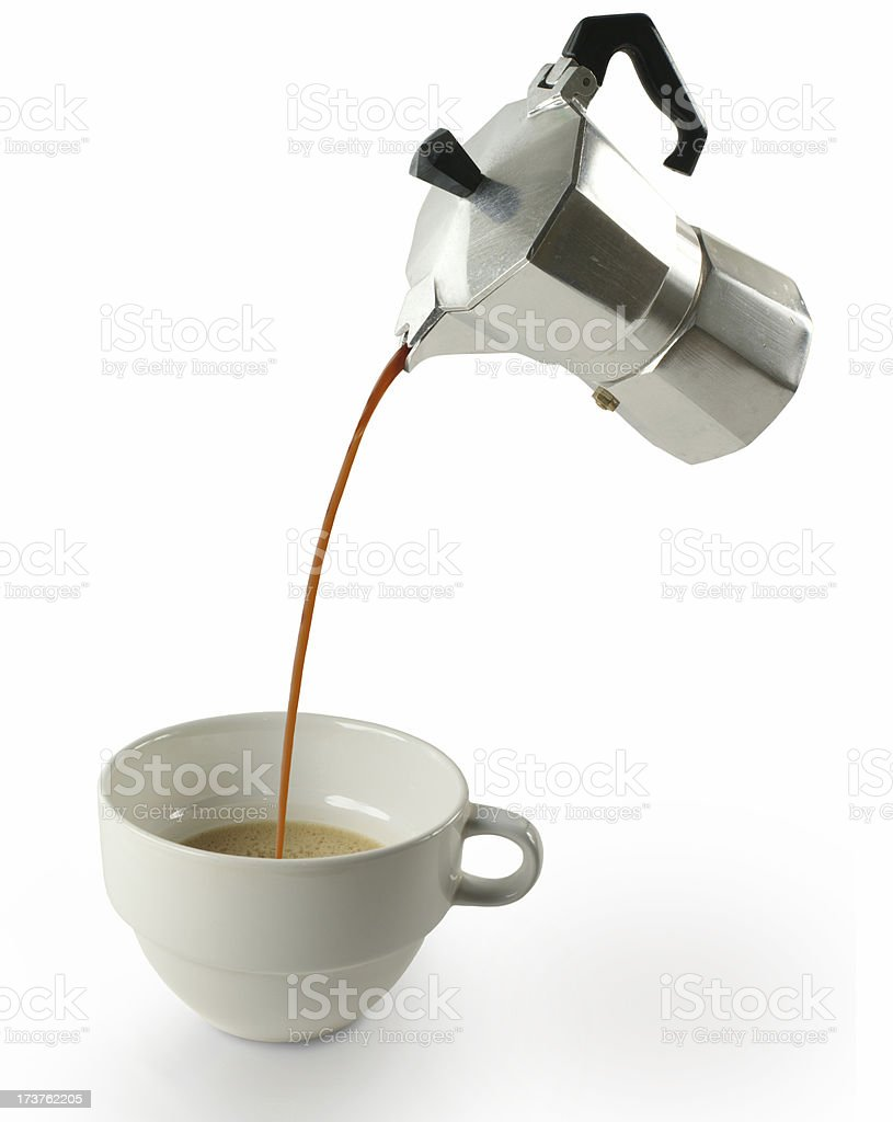 Stove-top Espresso Pot Pouring Into Cup royalty-free stock photo
