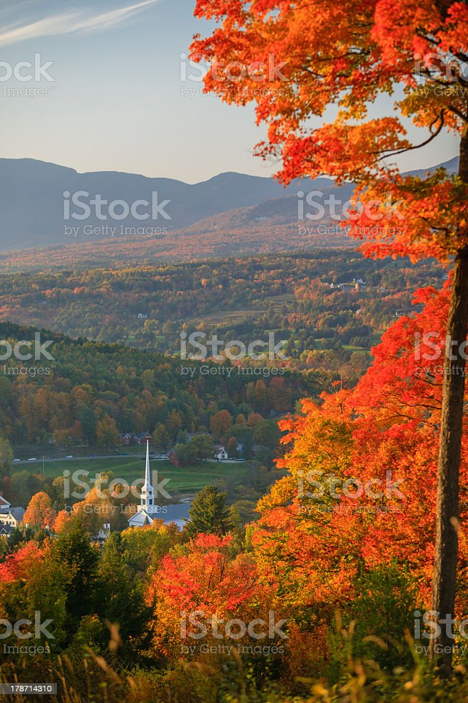Stowe Community Church surrounded by orange leaves in autumn stock photo