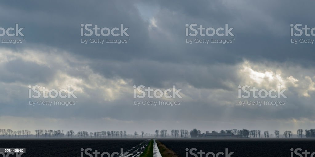 Straigh lines in a flat landscape in the Noordoostpolder, The Netherlands stock photo