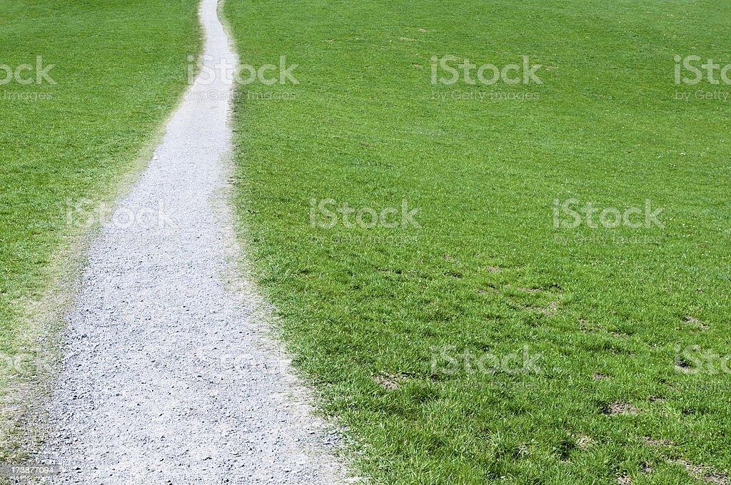 straight gravel walk through meadow royalty-free stock photo