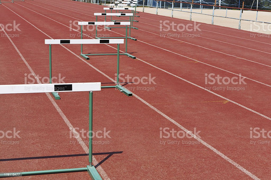 Straight lanes for track race with hurdles stock photo