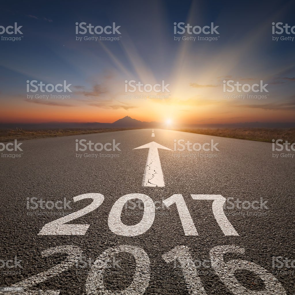 Straight open road to upcoming 2017 at idyllic sunset stock photo