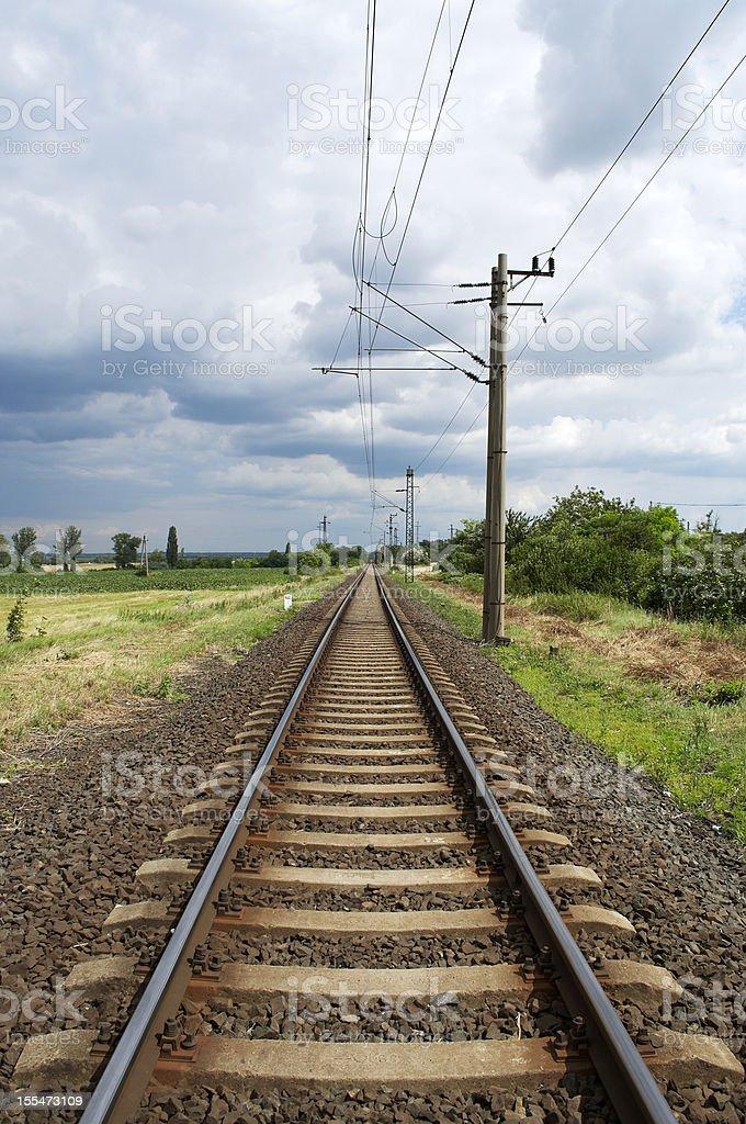 Straight railway leads to the horizon royalty-free stock photo