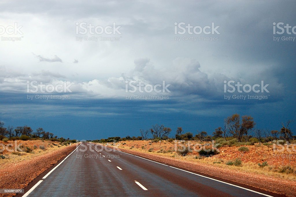 Straight road at australian outback cloudy sky stock photo