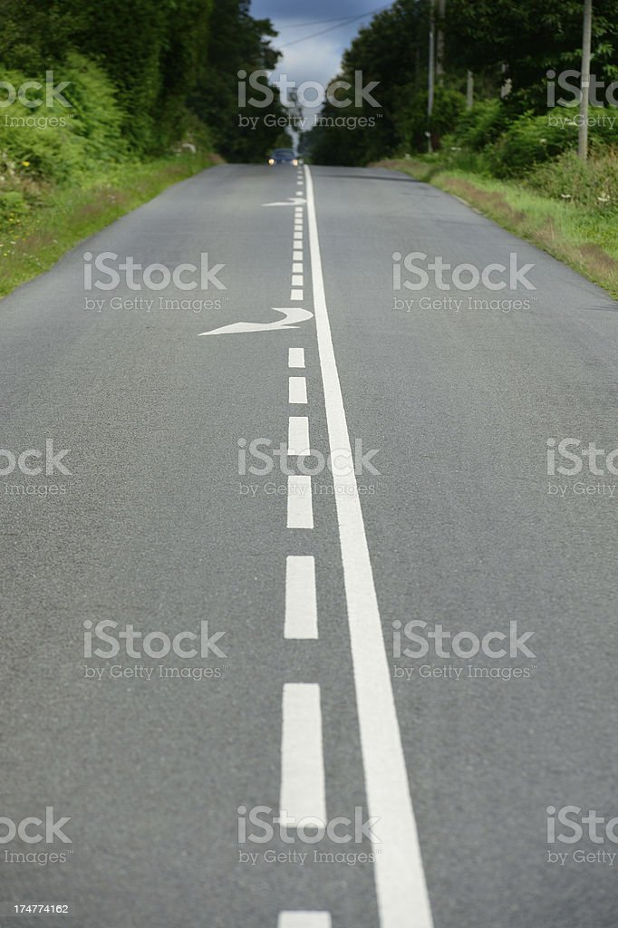 Straight road through colorful landscape, into darkness royalty-free stock photo