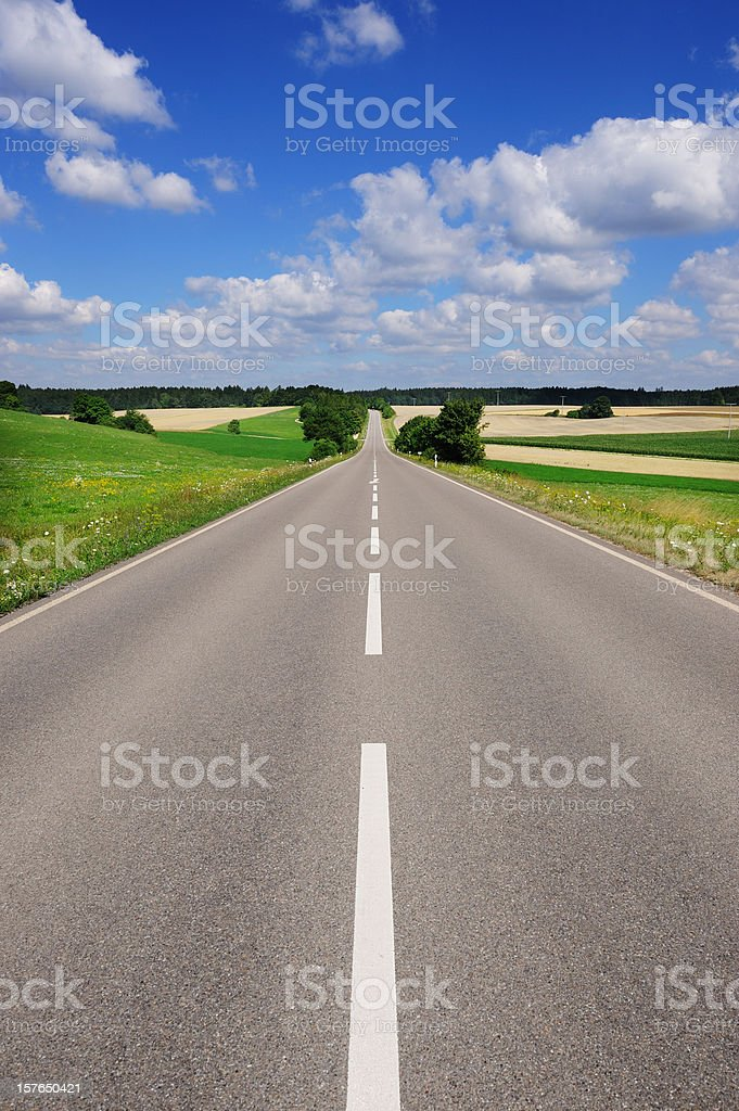 Straight road through colorful landscape stock photo