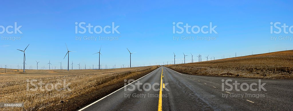 Straight Road through Wheat Field stock photo