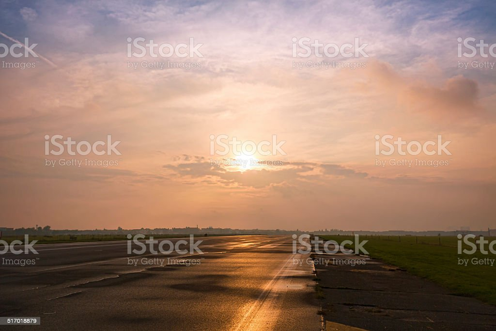 straight road to the horizon during the sunset stock photo