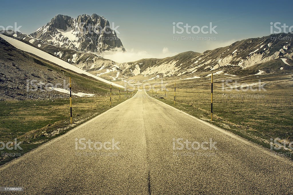 Straight Road to the Mountain Gran Sasso royalty-free stock photo