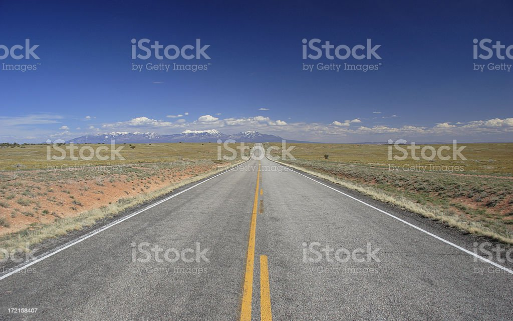Straight Road Towards Distant Mountains royalty-free stock photo