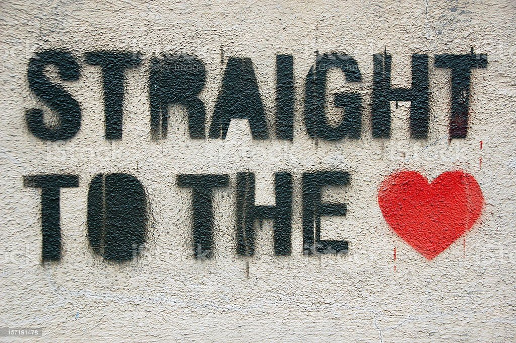 Straight to the heart graffiti stock photo