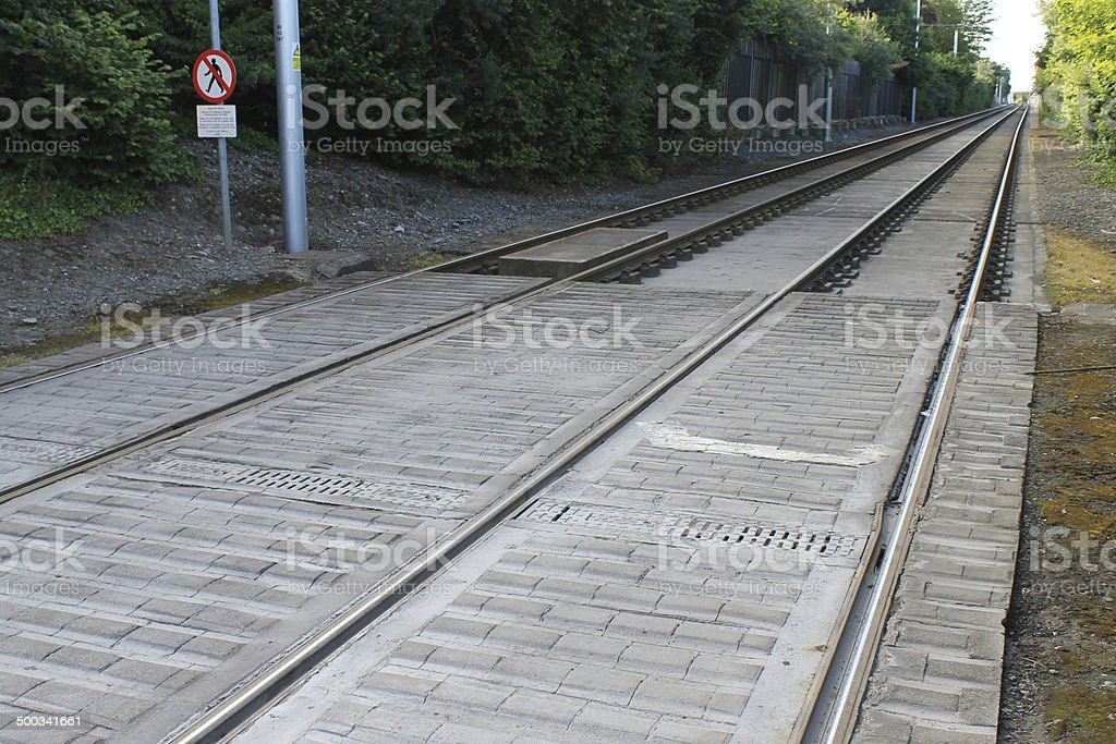 Straight Tram Tracks with Don't Walk Sign stock photo