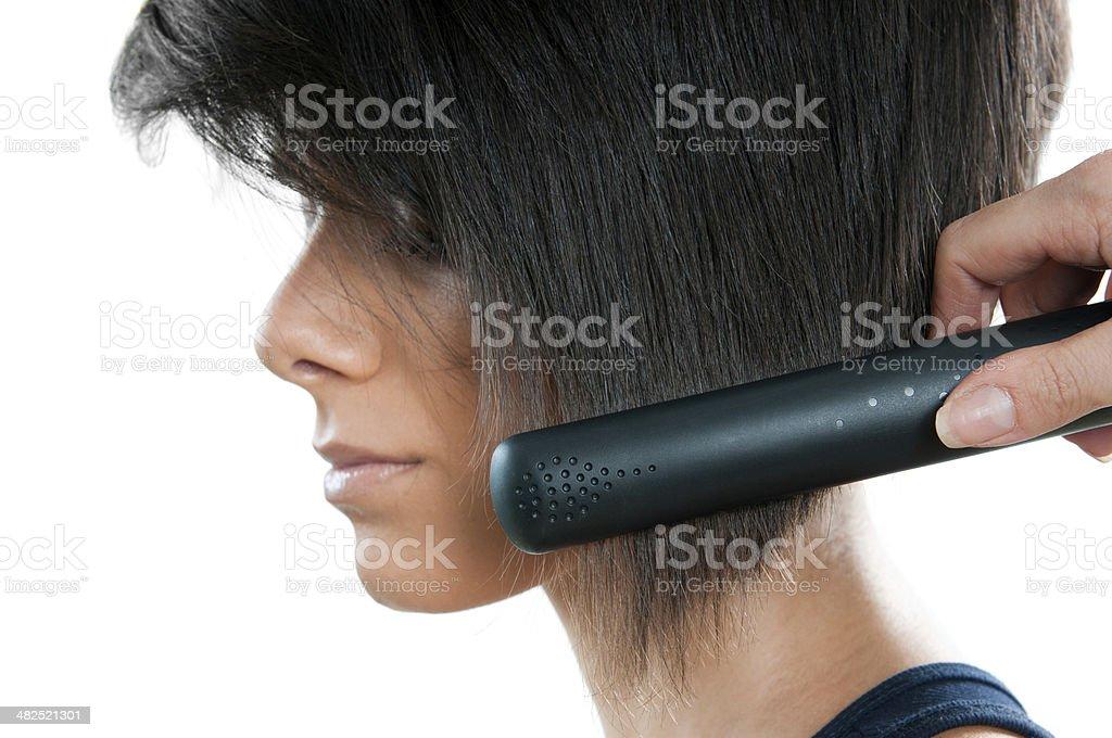 Straightening hair royalty-free stock photo
