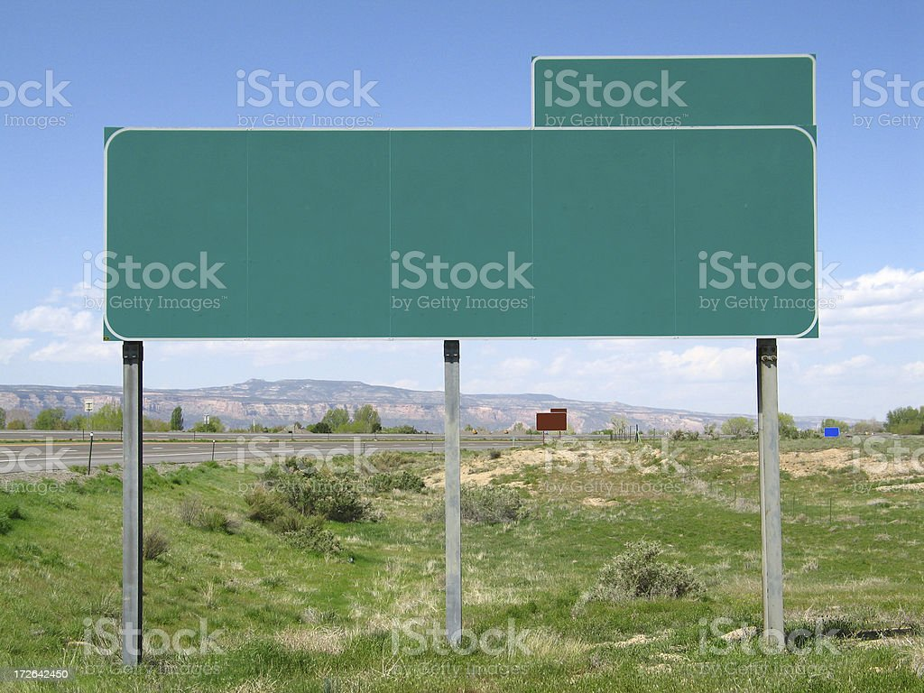 Straight-on Centered View of a Green Blank Highway Exit Sign stock photo