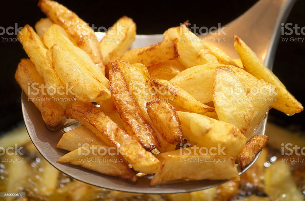 Strainer and fries stock photo