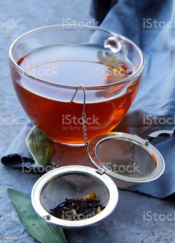 strainer with a fragrant black tea royalty-free stock photo