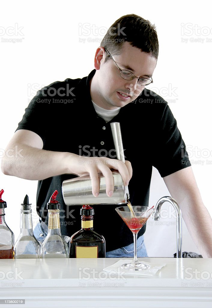 Straining a cocktail. royalty-free stock photo