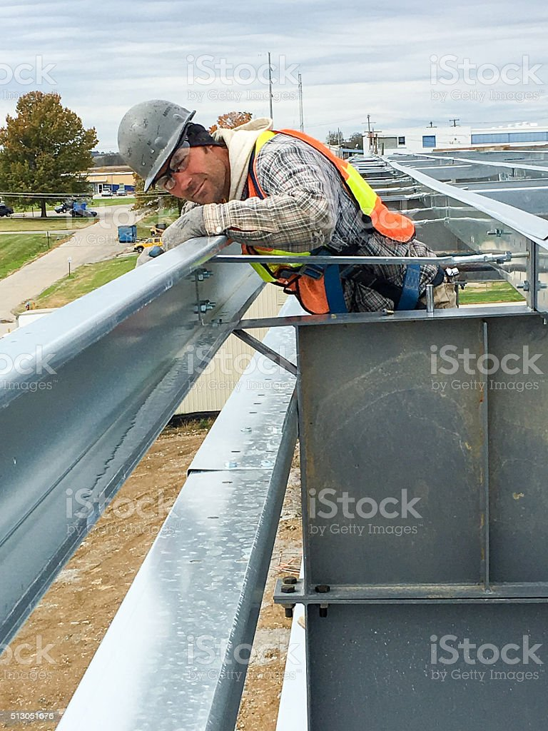 straitning the wall stock photo