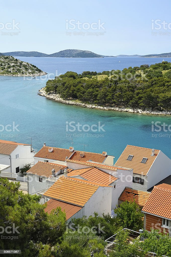 Straits between islands and village with red roofs stock photo
