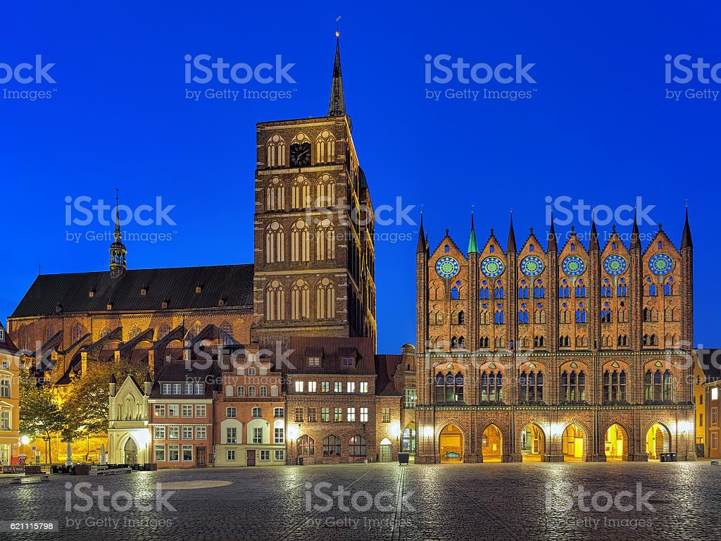 Stralsund, Germany. Night view of Nicholas' Church and City Hall. stock photo