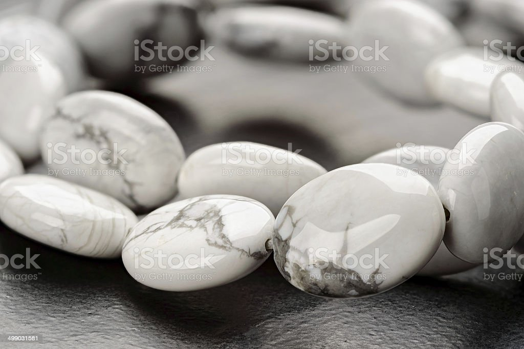 Strand of howlite beads stock photo