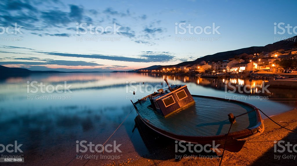 Stranded Boat at Sunset stock photo