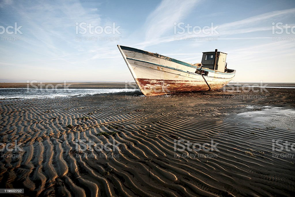 Stranded boat on the beach royalty-free stock photo