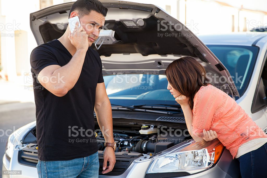 Stranded couple calling for help stock photo