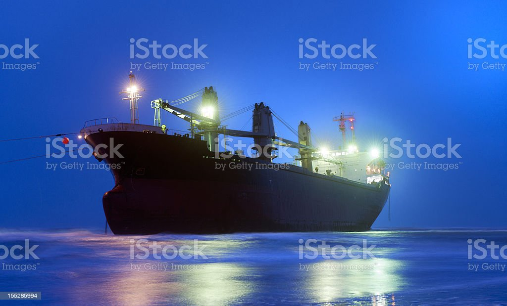 stranded empty container ship on beach royalty-free stock photo