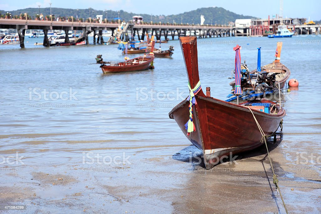 Stranded fishing boat at low tide near Rawai Landing Pier stock photo