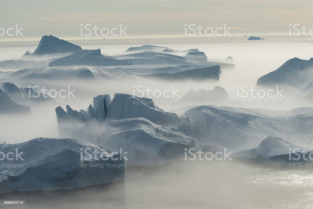 Stranded icebergs in the fog, Ilulissat, Greenland stock photo