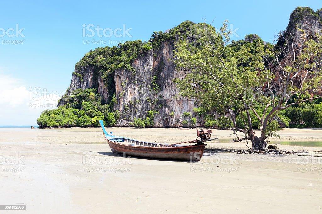 Stranded long tail boat at Phra Nang Beach stock photo