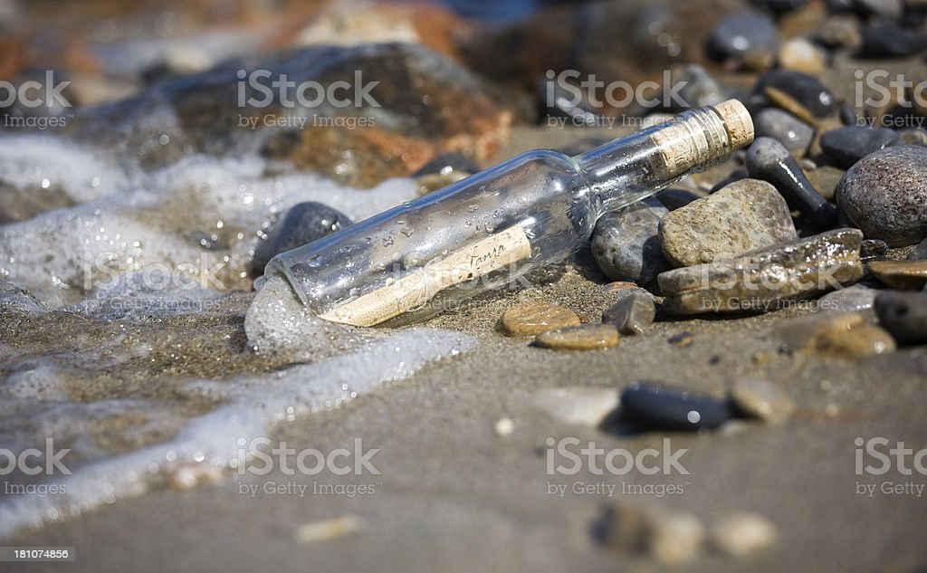 stranded message in the bottle royalty-free stock photo