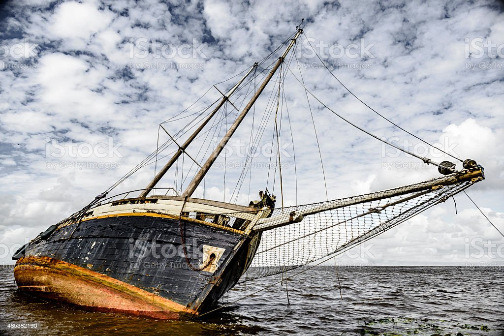 Stranded sailing boad shipwreck stock photo