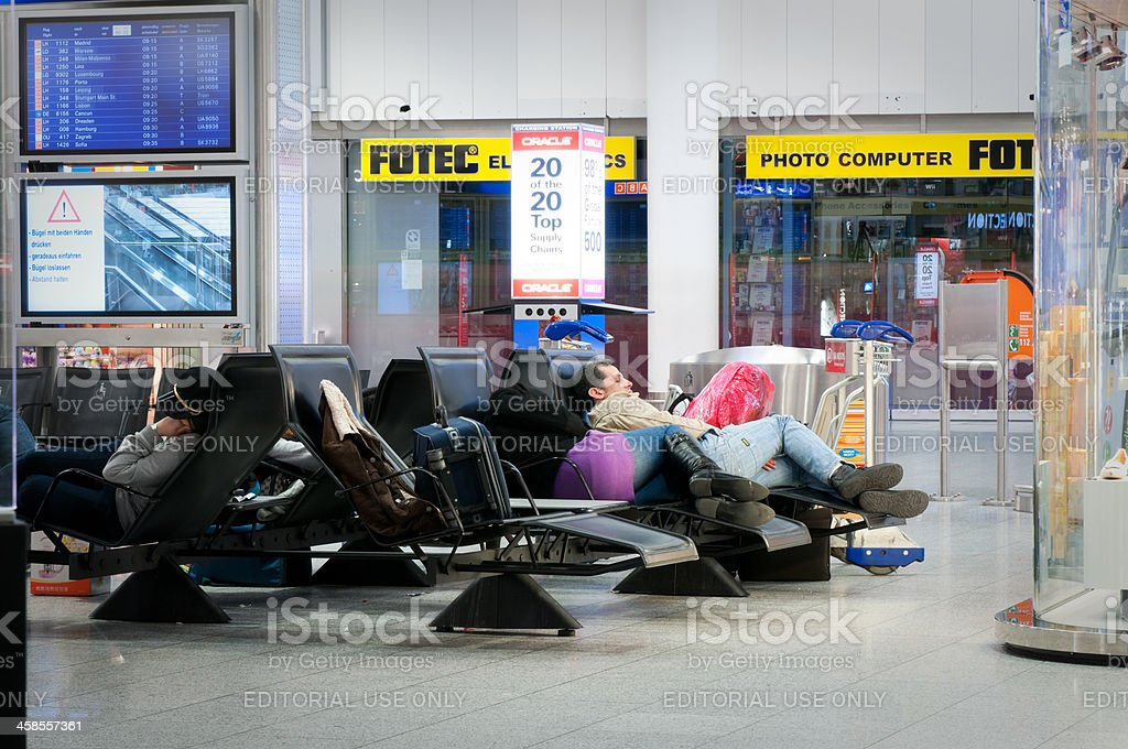 Stranded travellers sleeping at Frankfurt Airport Terminal 1 royalty-free stock photo