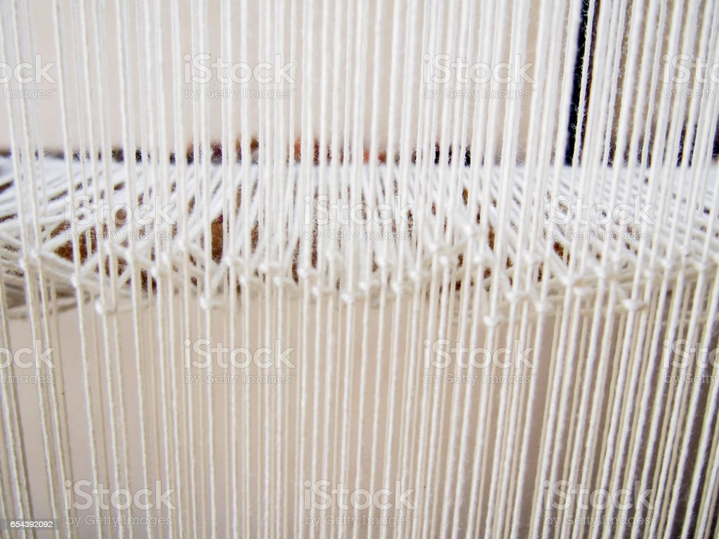 Strands of White Yarn on a Loom stock photo