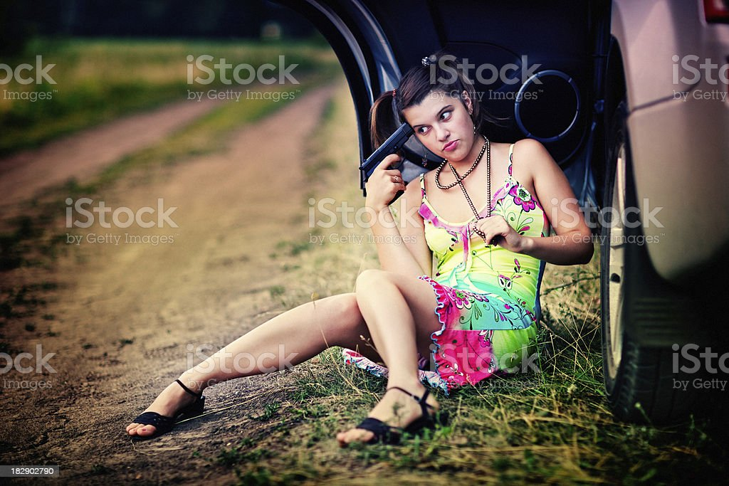 Strange girl going to shoot yourself in the head royalty-free stock photo