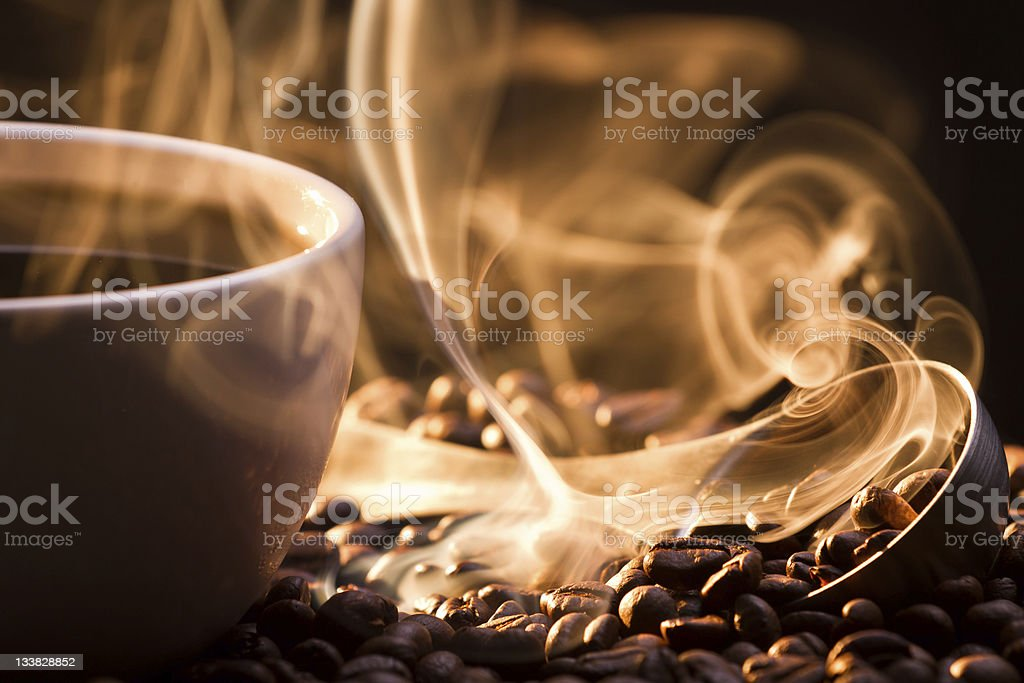 Strange golden smoke taking away from coffee seeds stock photo