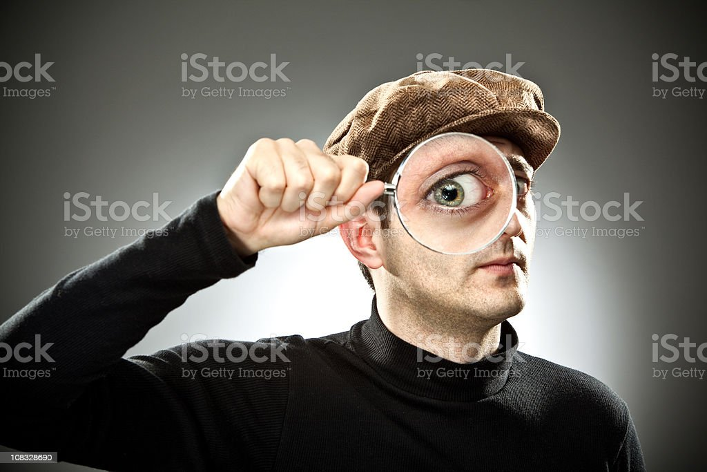 Strange man examines with magnifier glass stock photo