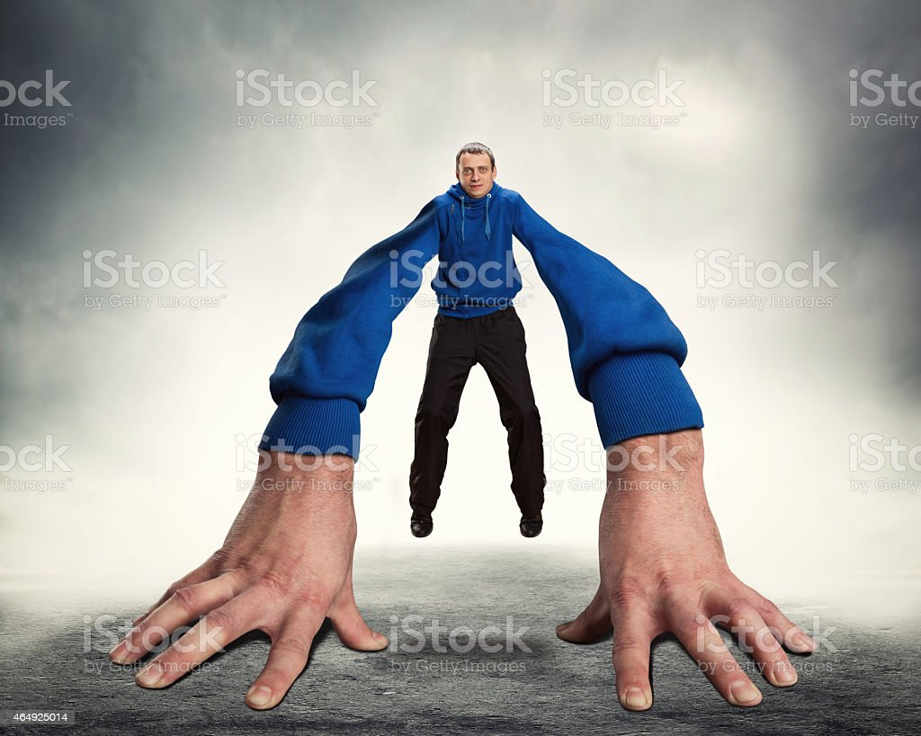 Strange man with big hands stock photo