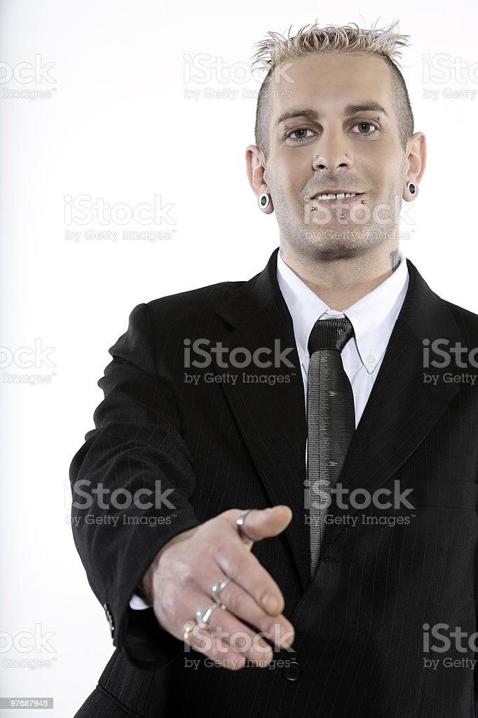 strange punk business man with piercing handshake royalty-free stock photo
