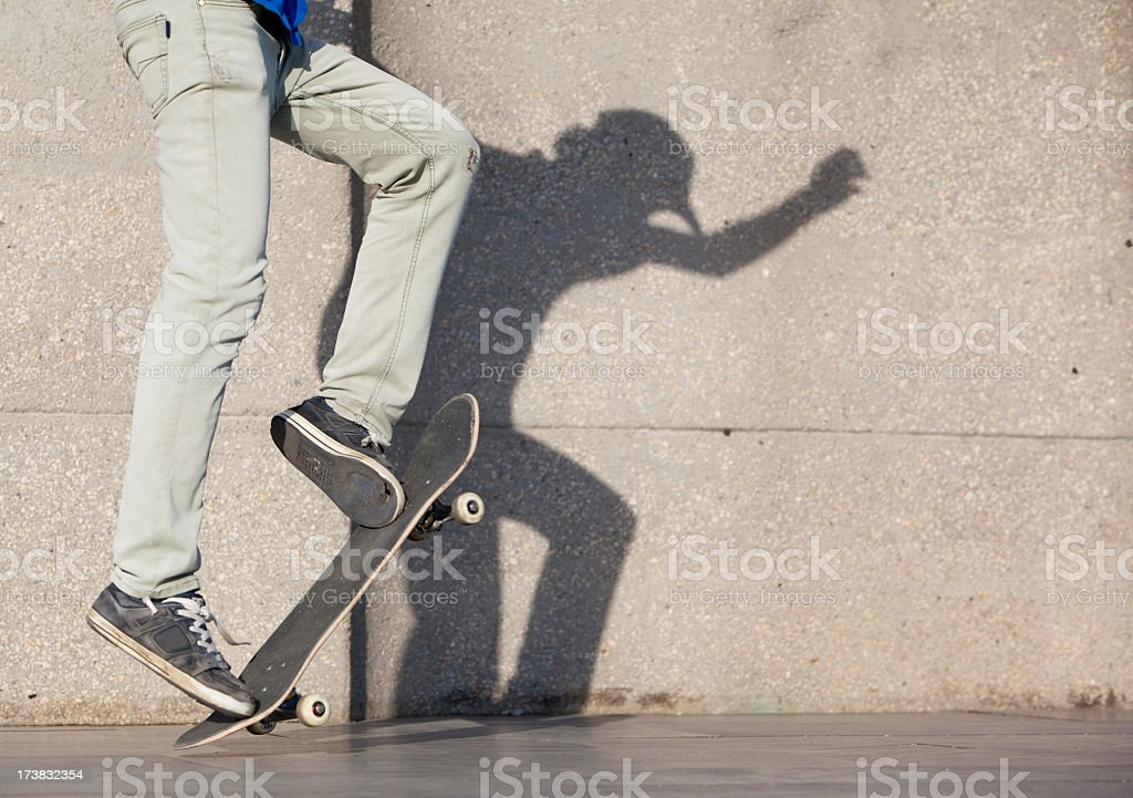 strange shadow of the jumping skateboarder royalty-free stock photo