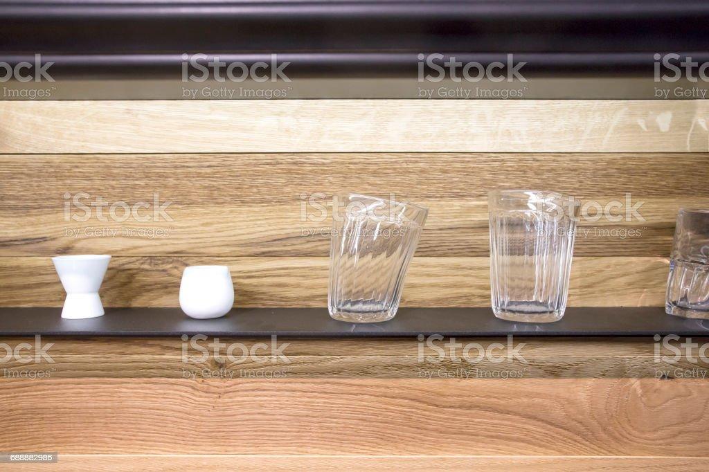 strange soft glasses on the shelf stock photo