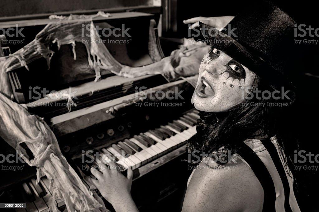 Strange Woman In Top Hat Singing/Playing At An Old Organ stock photo